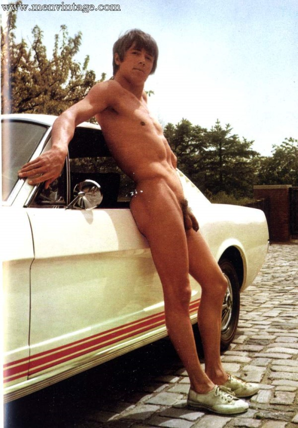 naked guy by the car